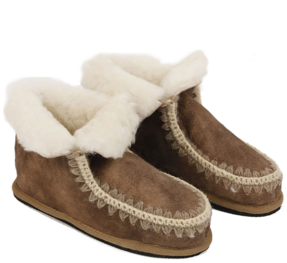 Made of Synthetic Ankle boot style Back heel tab to easily pull slipper on Ultra-soft lining that hug your feet Indoor/outdoor sole Machine washable These bootie slippers are a great b Gilligan & O'malley Slipper boots Sz S NWT.